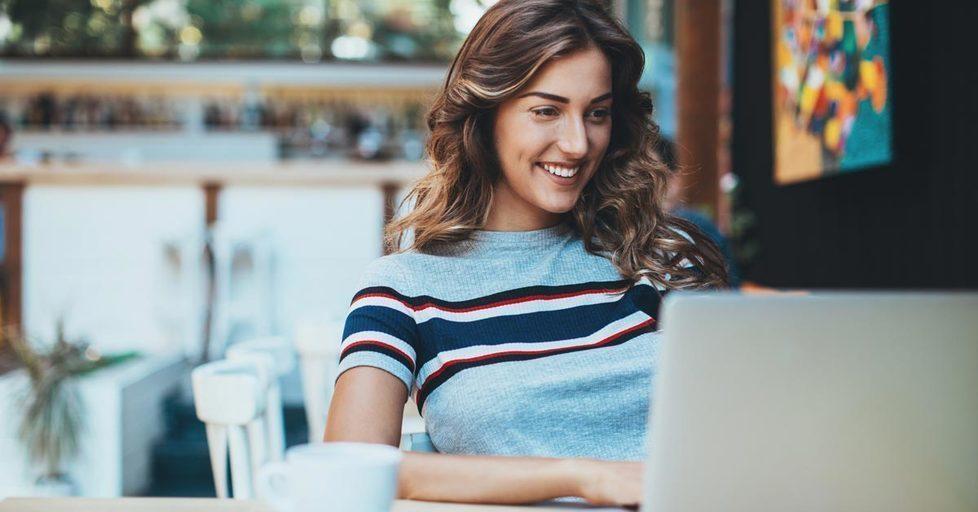 Woman-working-cafe-laptop