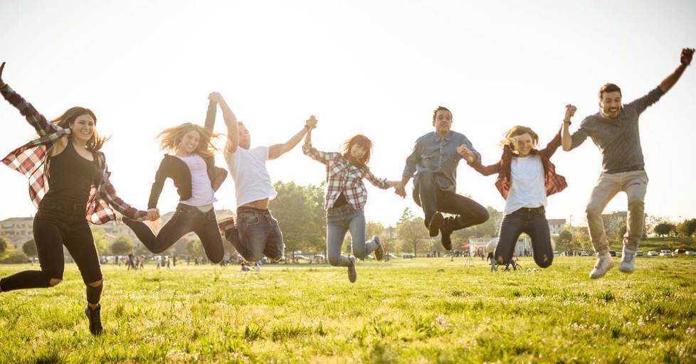 Group-of-people-jumping-on-the-park-at-dusk