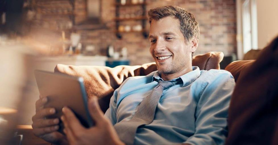 Man-using-tablet-smiling